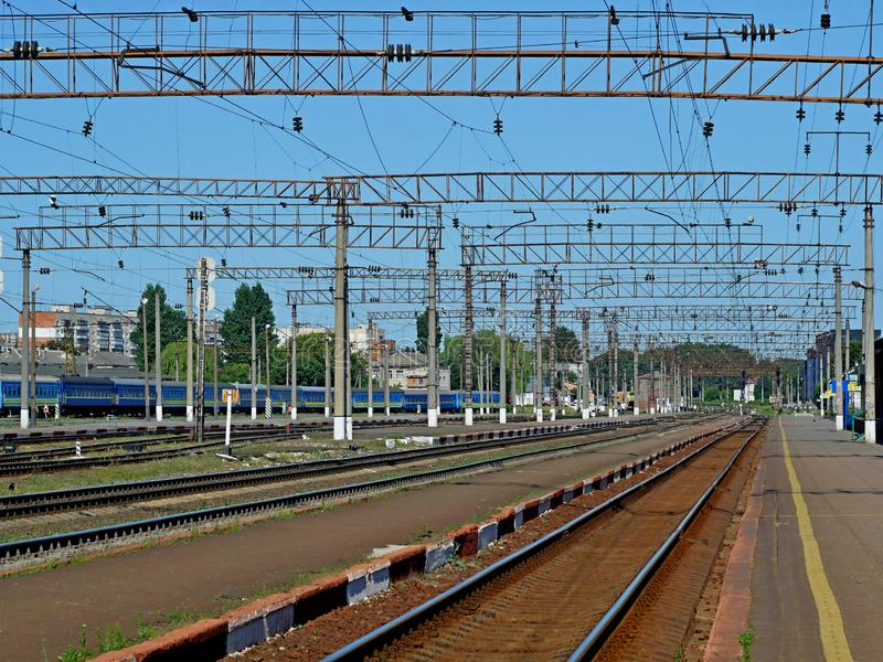 Infrastructure of railway station of Khmelnytskyi, Ukraine. In sunny morning with cloudless blue sky stock photography