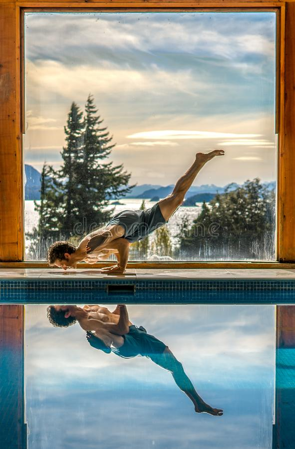 Yoga Poses by Pool. Infront of mountains and lake with reflection in pool, landscape, nature, active, adult, arm, asana, body, concentration, exercise, fit stock photography