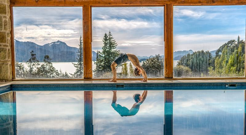 Yoga Poses by Pool. Infront of mountains and lake with reflection in pool, landscape, nature, active, adult, arm, asana, body, concentration, exercise, fit royalty free stock photos