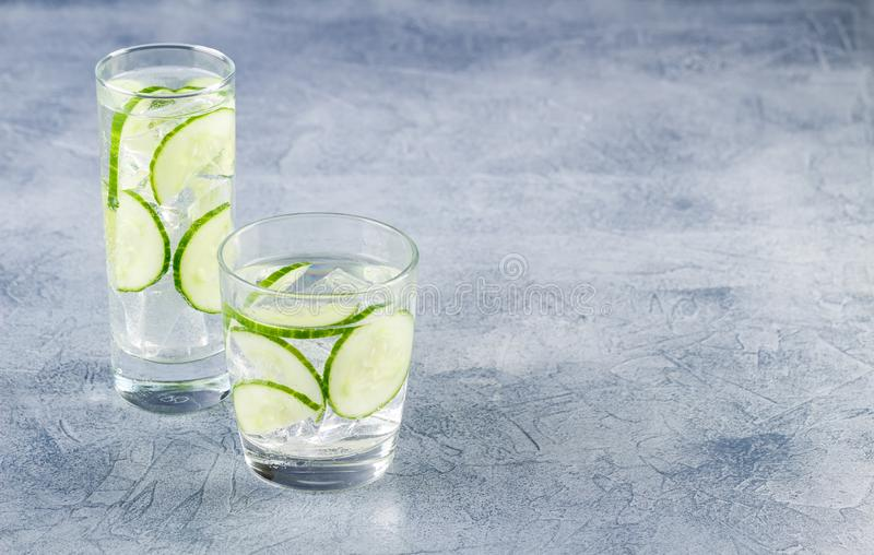 Infused water with cucumber and ice stock image