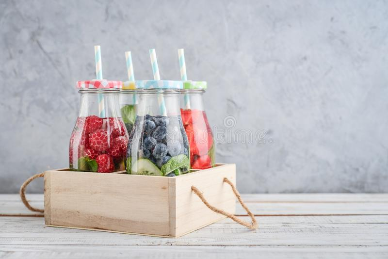 Infused water with fresh fruits royalty free stock photography