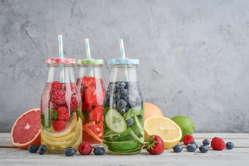 Infused water with fresh fruits stock images
