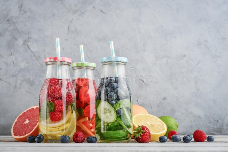 Infused water with fresh fruits stock image
