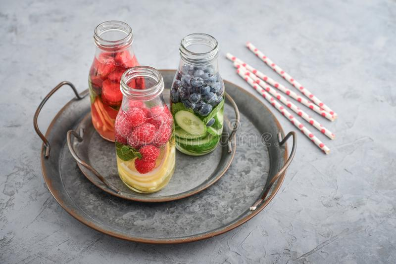 Infused water with fresh fruits stock photography