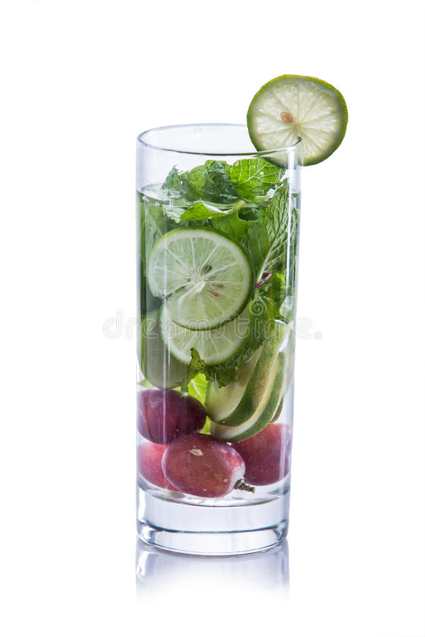 Infused water mix of lime, grape and mint leaf. Summer fresh fruit Flavored infused water of lime, grape and mint leaf stock photos