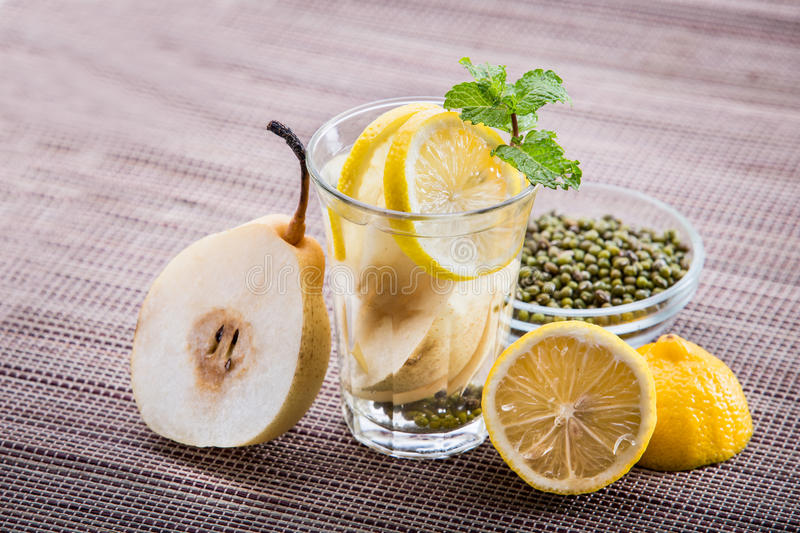 Infused water mix of pear, lemon and mung bean royalty free stock photography