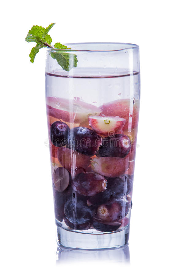 Infused water mix of purple grape and red grapes. Fresh fruit Flavored infused water mix of purple grape and red grapes. isolated over white background stock photos