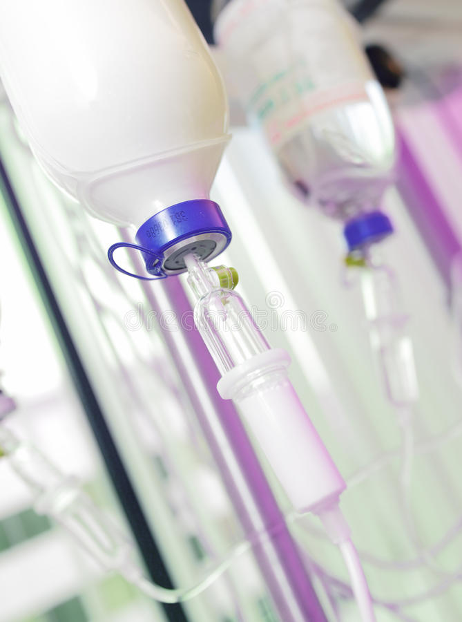 Infusion bottles with IV solution. Infusion with medications stock image