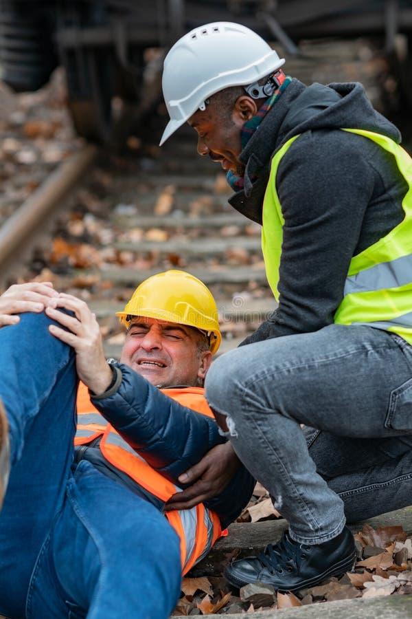Ingénieur blessé au travail photo stock
