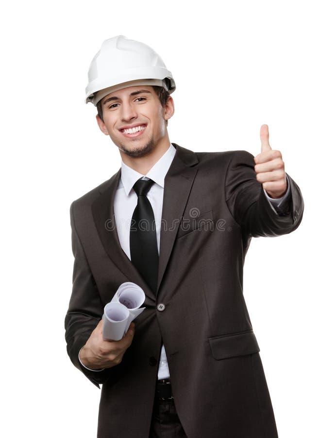 Ingénieur dans des pouces de casque antichoc vers le haut photo libre de droits