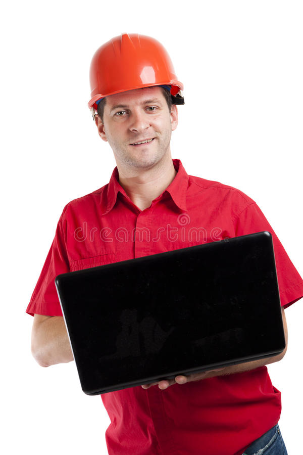 Ingénieur de construction à l'aide de son ordinateur portable photo stock