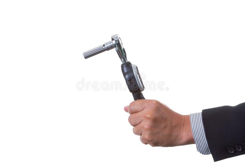 Ingénieur de mécanicien tenant la clé dynamométrique numérique dans sa main image libre de droits