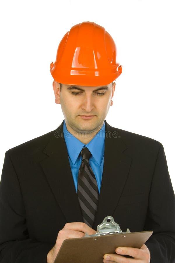 Ingénieur prenant des notes photographie stock