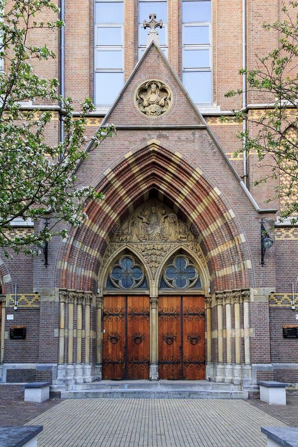 Ingang aan het vergaderingscentrum Posthoornkerk stock foto's