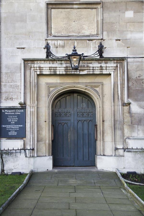 Ingang aan St Margarets Kerk, de Abdij van Westminster, Londen, Engeland royalty-vrije stock afbeelding