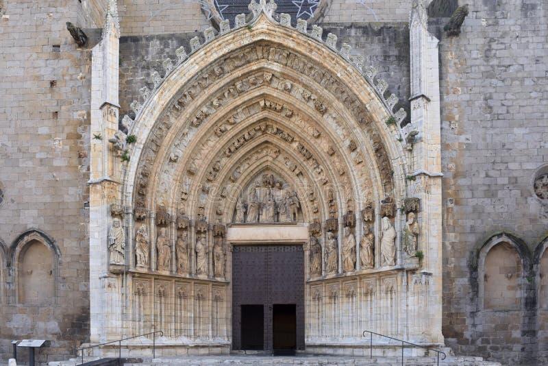 Ingang van de gotische kathedraal van Santa Maria in Castello D Em stock foto's