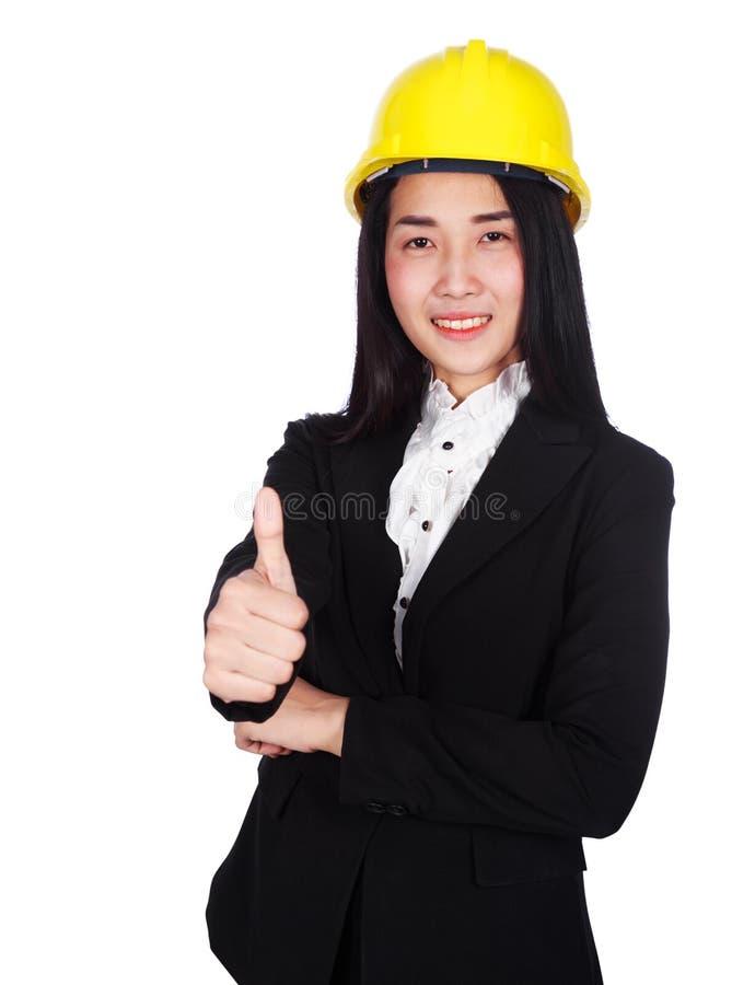 Ingegnere felice della donna di affari con i pollici sul gesto isolati sopra fotografie stock