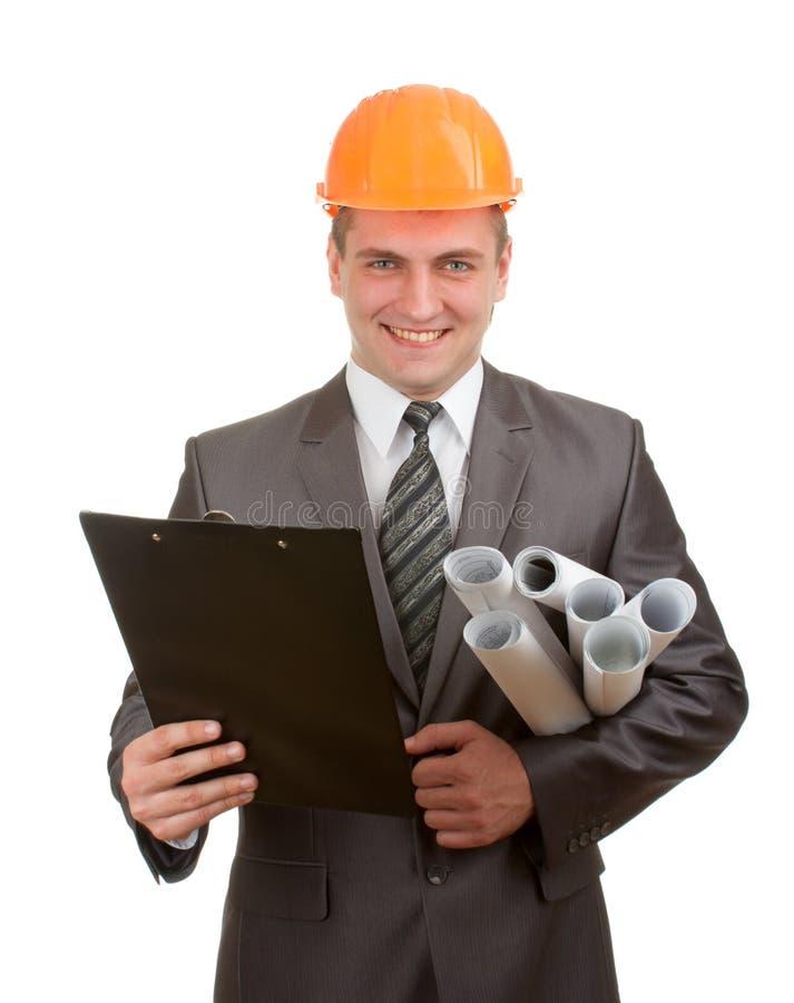 Ingeniero con planes y el sujetapapeles imagen de archivo