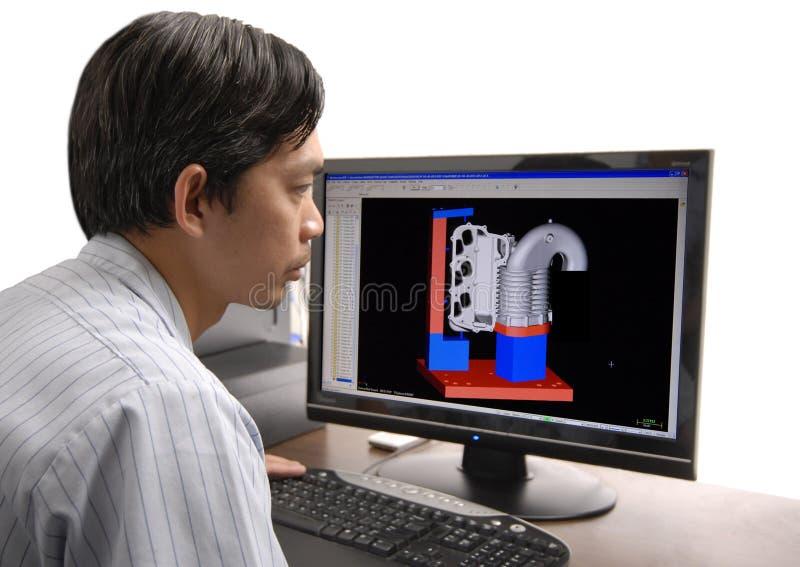 Ingeniero del cad en el trabajo imagen de archivo libre de regalías