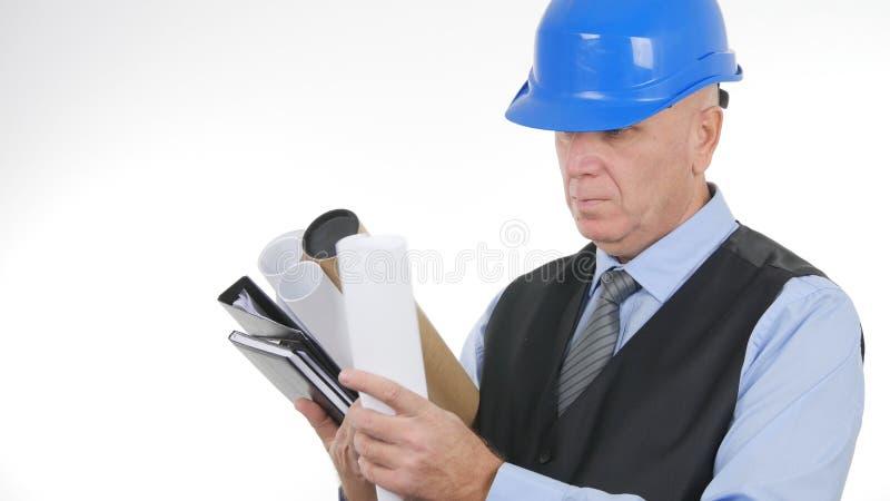 Ingeniero Image Interior Office con planes y proyectos a disposición imagen de archivo libre de regalías