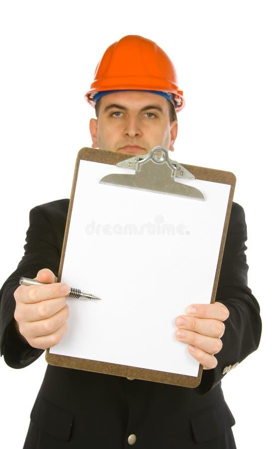 Ingeniero que señala con la pluma foto de archivo