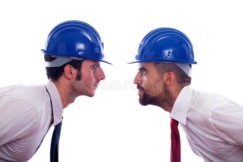 Ingenieros con el casco foto de archivo libre de regalías