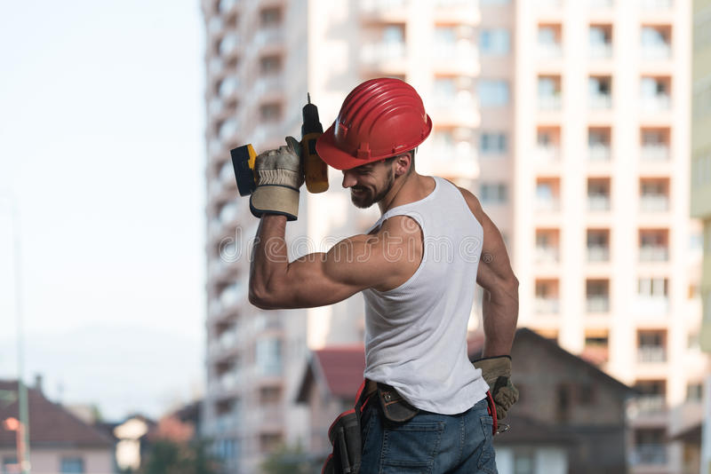 Ingenieur Construction Wearing ein roter Sturzhelm lizenzfreie stockbilder