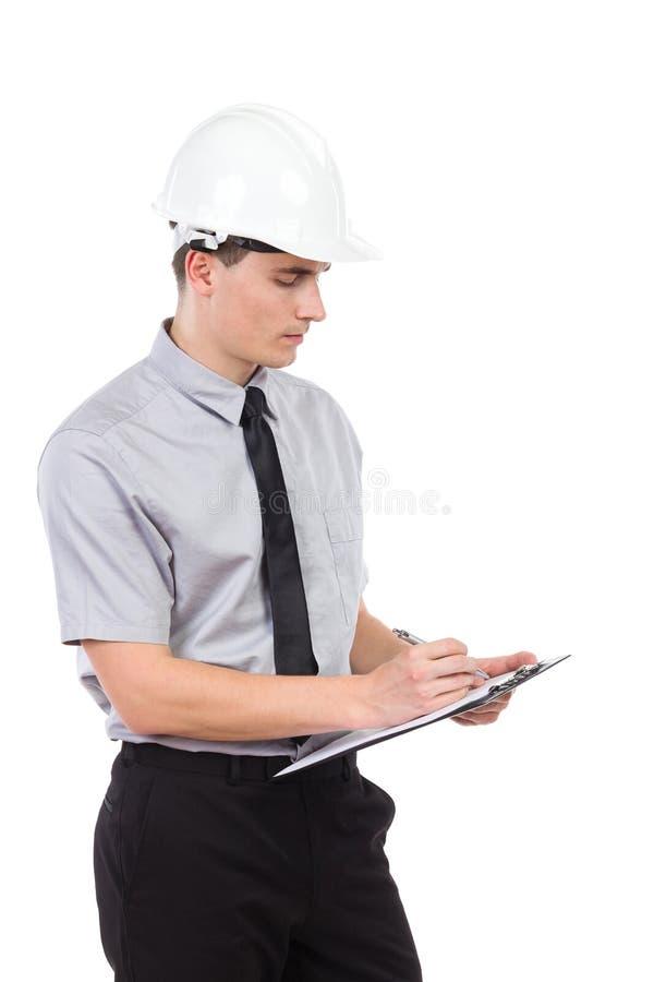 Ingenieur, der eine Kenntnis nimmt stockbilder
