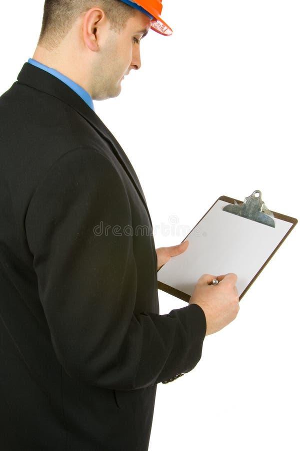 Ingenieur die nota's neemt stock fotografie