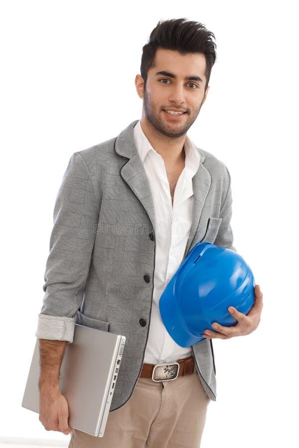 Ingenieur mit Laptop und Hardhat lizenzfreie stockbilder