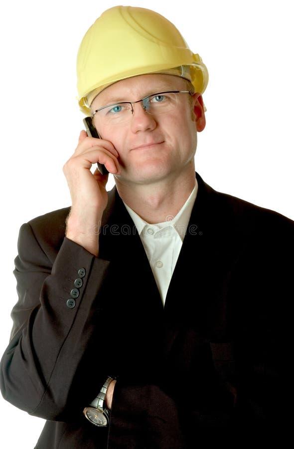 Ingenieur mit Mobiltelefon stockbild