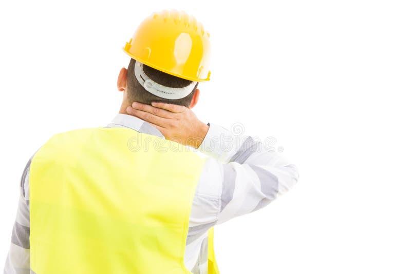 Ingenieur oder Architekt, die hinteren Nackenschmerzen glauben stockbild