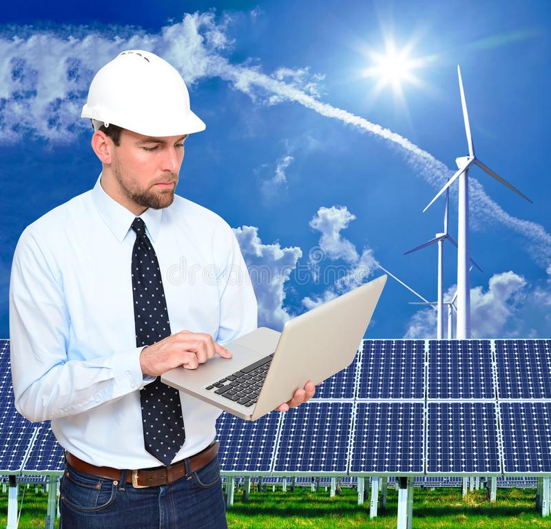 Ingenieur works in the energy industry - environmentally friendly power generation with alternative energies such as wind and sol. Ar energy - closeup with royalty free stock photo