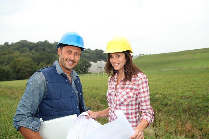 Ingenieurs op bouwterrein royalty-vrije stock foto