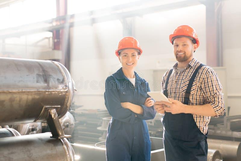 Ingenieurs op het Werk stock afbeeldingen