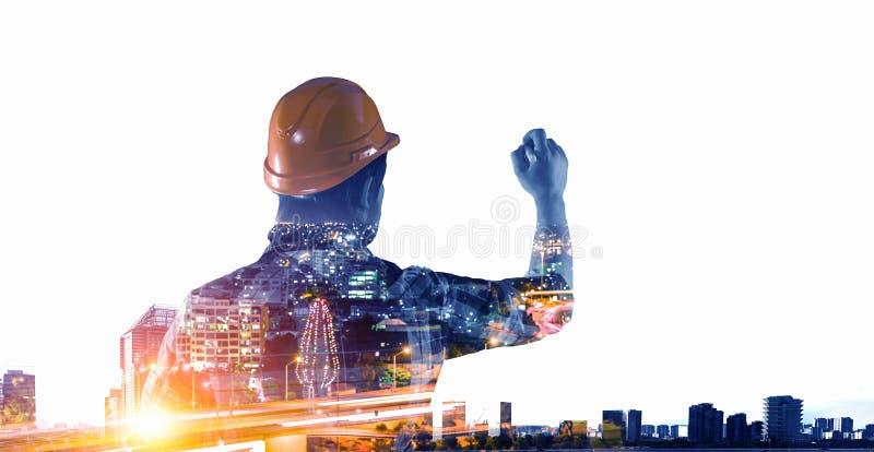 Ingenieursmens en cityscape Gemengde media stock fotografie