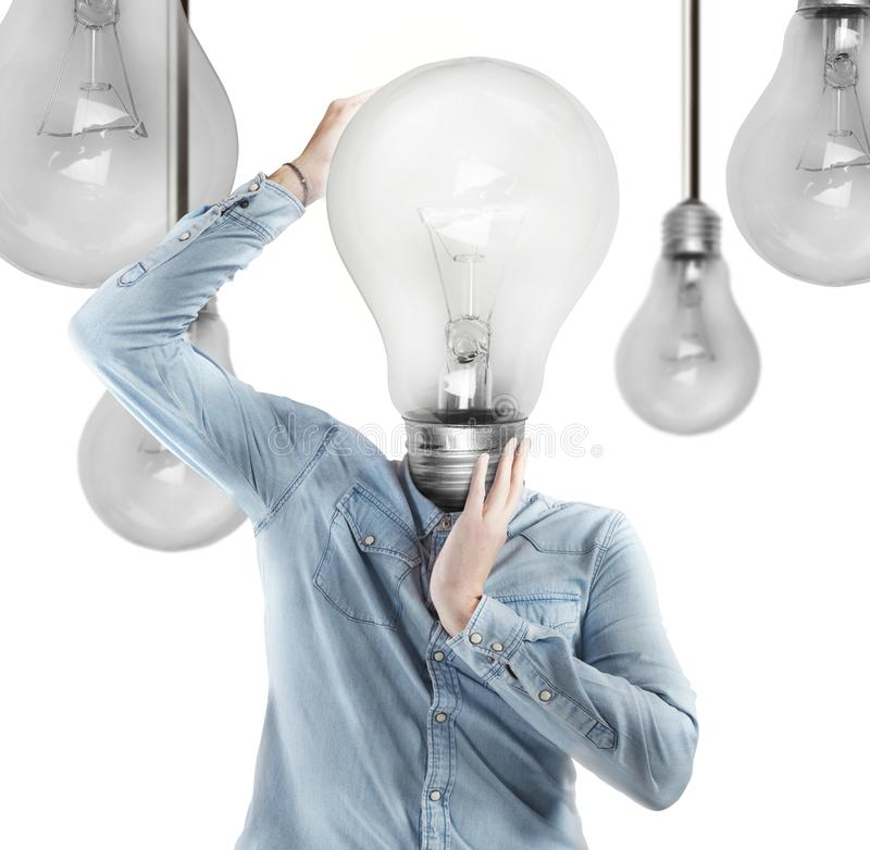 Ingenious head. Man with a light bulb as head stock images