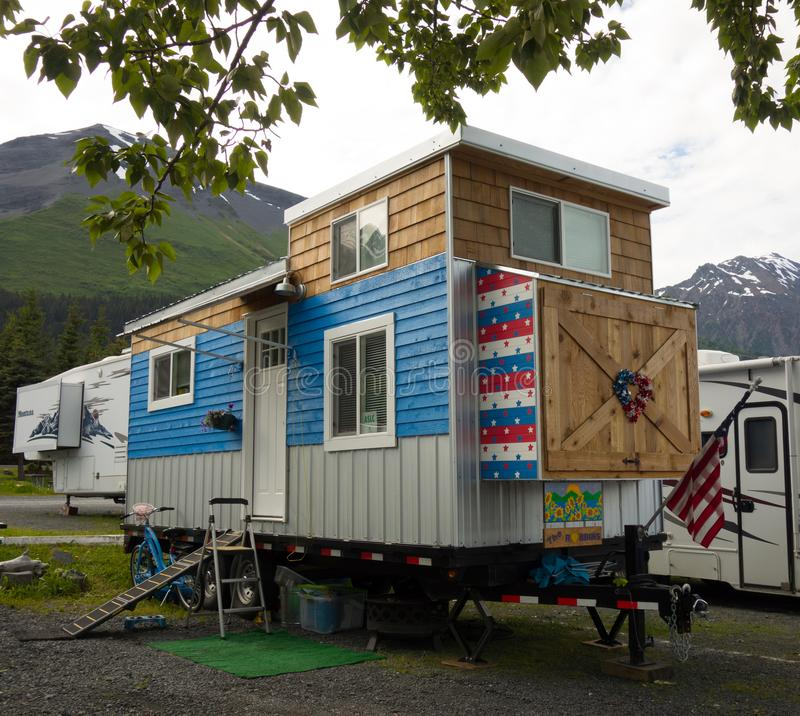An incredible tiny house on wheels as seen at a campground in alaska royalty free stock image