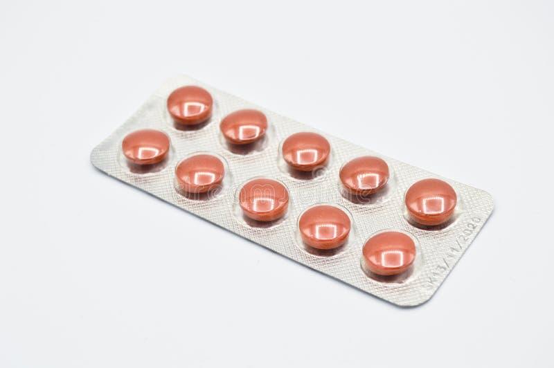 Ingepakt om kleine bruine pillen Geneeskunde, arts royalty-vrije stock afbeeldingen