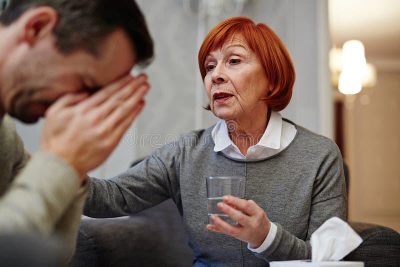 Ingewikkelde zitting met patiënt royalty-vrije stock afbeelding