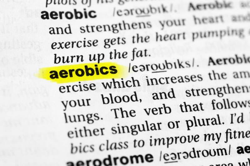 ` Inglés destacado de los aeróbicos del ` de la palabra y su definición en el diccionario foto de archivo libre de regalías