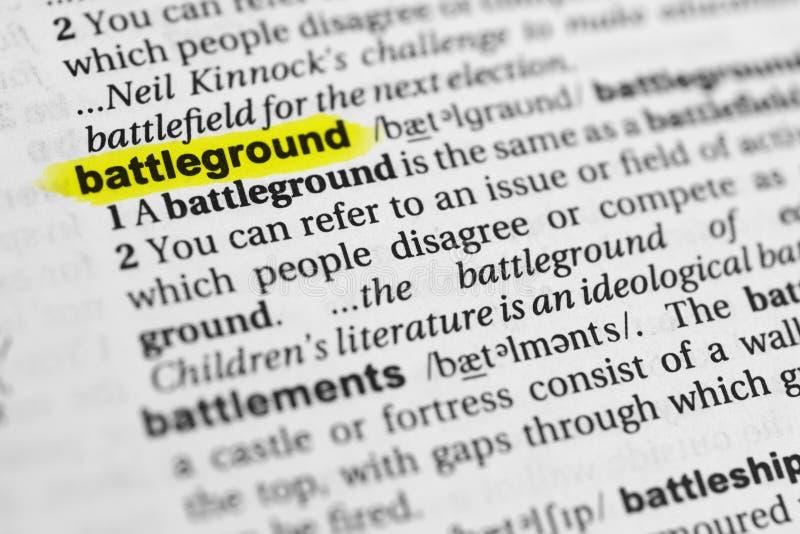 ` Inglés destacado del campo de batalla del ` de la palabra y su definición en el diccionario imágenes de archivo libres de regalías