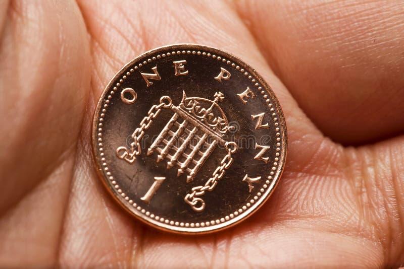 Ingleses uma moeda da moeda de um centavo fotografia de stock royalty free