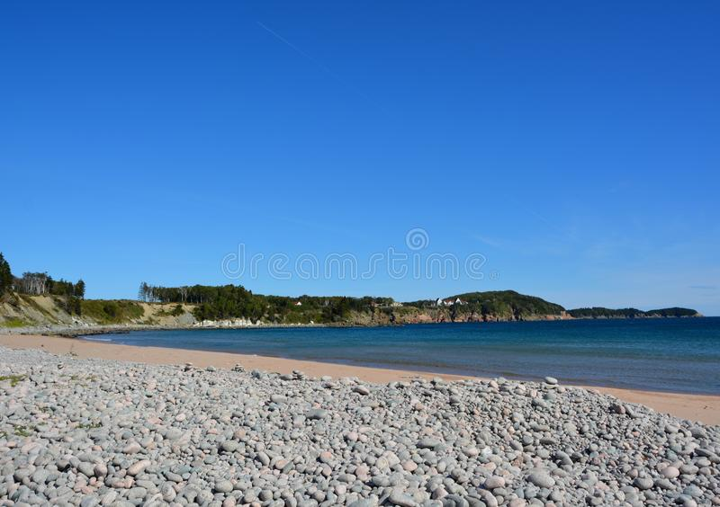 Ingonish Beach, Cabot Trail. Ingonish Beach at Cape Breton Highlands National Park along the famous Cabot Trail Nova Scotia Canada; Keltic Lodge Resort in the royalty free stock image
