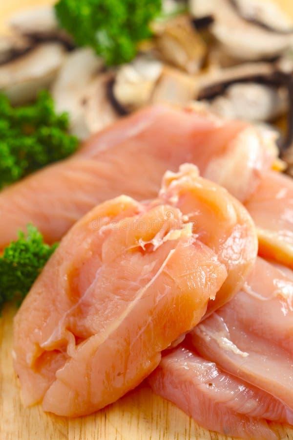 Ingrédients de poulet et de champignon de couche verticaux images libres de droits