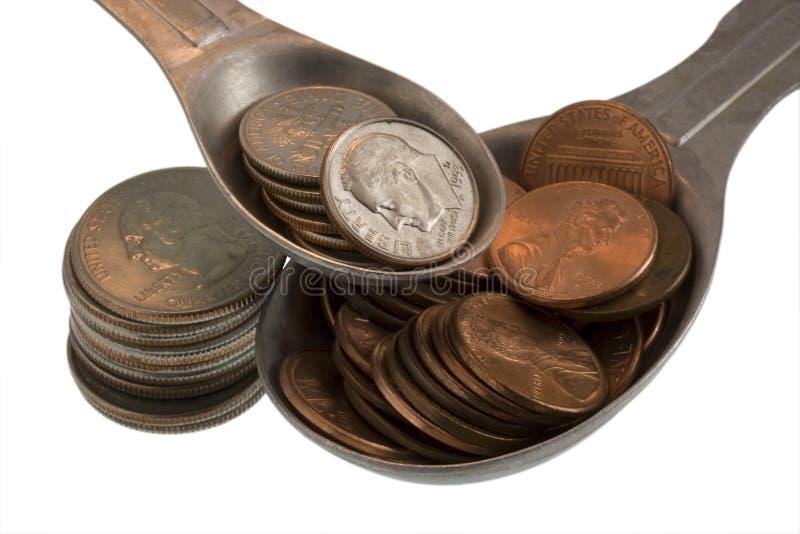 Ingrédients de recette de richesse : penny, dixièmes de dollar, quarts photographie stock libre de droits