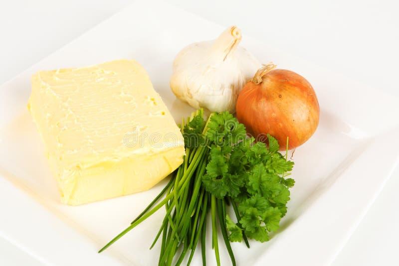 Ingrédients pour un beurre persillé image stock
