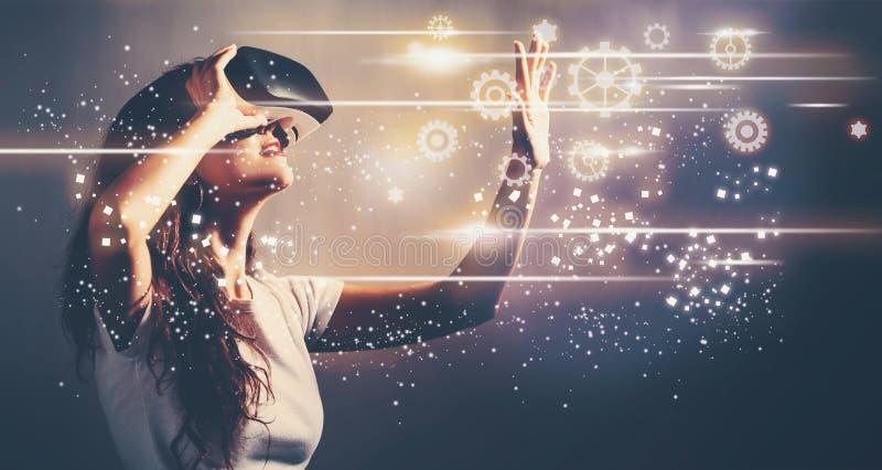 Ingranaggi con la giovane donna con VR illustrazione di stock