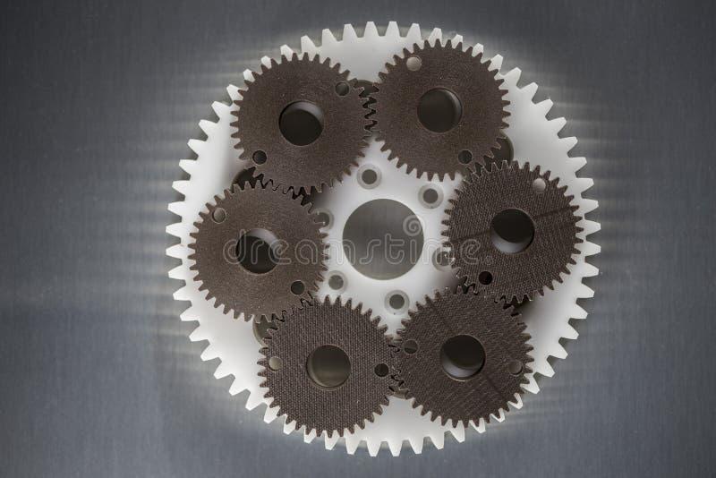 Ingranaggi industriali fatti dalla plastica fotografie stock