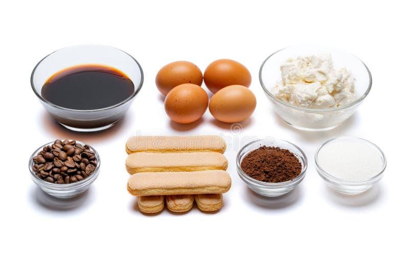 Ingredienser för att laga mat tiramisuen - Savoiardi ljusbruna kakor, mascarpone, kräm, socker, kakao, kaffe och ägg royaltyfria bilder